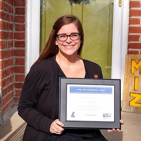 Photo: Sarah Scott holding certificate from Leadership St. Joseph program